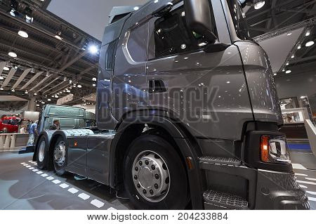 MOSCOW, SEP, 5, 2017: View on gray three axle truck Scania exhibit on Commercial Transport Exhibition ComTrans-2017. Scania trucks. Automobile industry. Popular and newest Commercial trucks