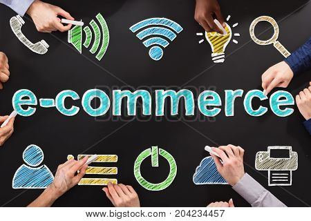 People Drawing Ecommerce Online Shopping Concept On Blackboard