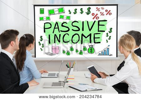 Group Of People Watching Passive Income Presentation