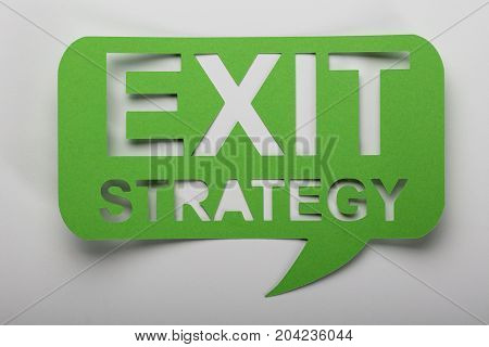 Elevated View Of Exit Strategy Text On Green Speech Bubbble
