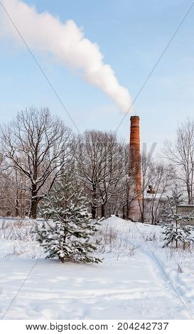 Winter landscape. A thick smoke fling from factory chimneys. Smoke from a thermal power plant on a cold winter day. Heating.