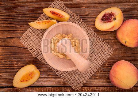 Fresh Made Peach Powder On A Rustic Background