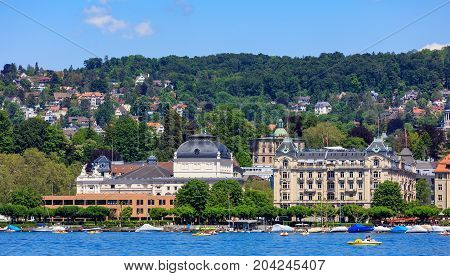 Zurich, Switzerland - 26 May, 2016: buildings of the city of Zurich along Lake Zurich. Zurich is the largest city in Switzerland and the capital of the Swiss canton of Zurich, lake Zurich is the lake extending southeast from the city of Zurich.