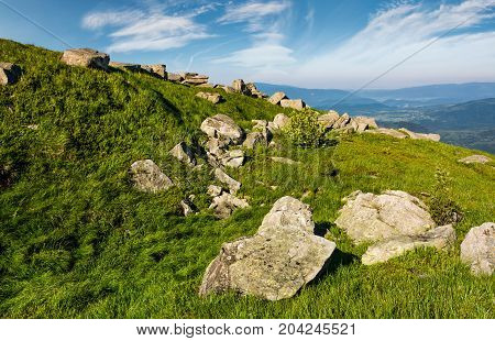 Huge Boulders On A Grassy Slope In Mountains
