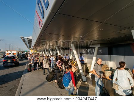 New York August 19 2017: People are going curbside check-in for Delta Airline flights at JFK airport.