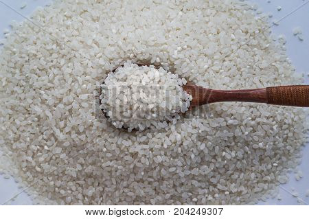 Rice In Pot With Wood Spoon
