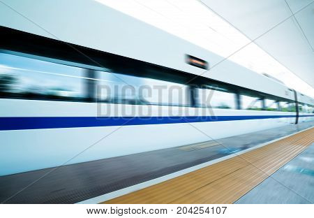 Dynamic high-speed train passing through the platform