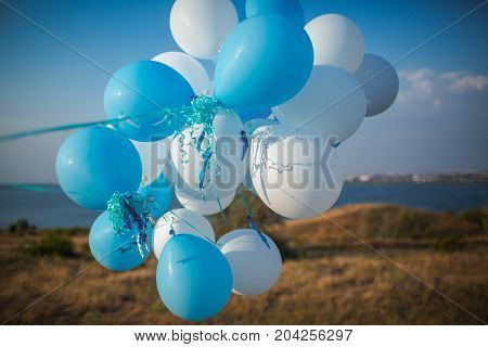 A bunch of white and blue balls against the background of the river
