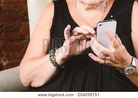 Old Woman Typing On Phone.