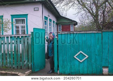 Zhytomyr, Ukraine - May 03, 2015: old woman live in abandoned village near the pripyat