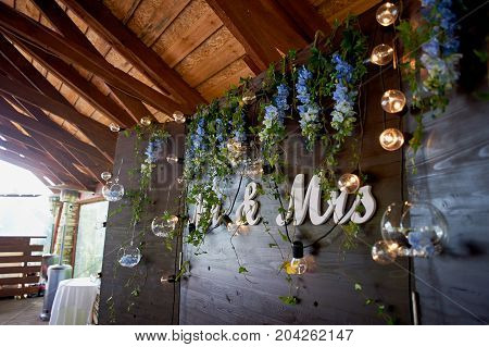 The decoration of the wedding area bride and groom. The inscription mr mrs over the table.