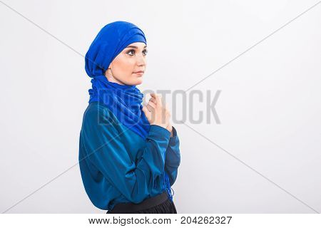 Portrait of young muslim woman wearing traditional arabic clothing.