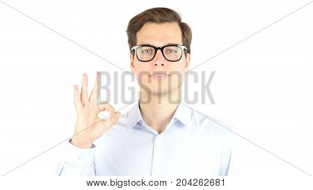 Young Man Shows Sign And Symbol Ok Isolated On White Background
