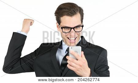 Happy Bussinessman Holding Smartphone And Celebrating His Success , Good News