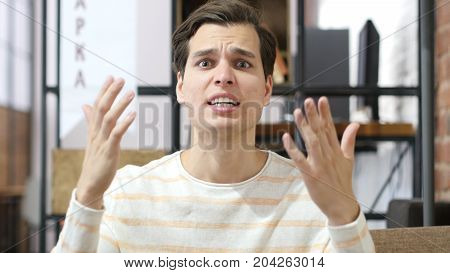 Bad-tempered Caucasian Young Man Yelling On His Team
