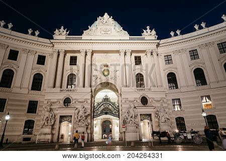 Vienna, Austria - August 16, 2017: Facade to St. Michael Square in Hofburg Palace. It has been the seat of power of the Habsburg dynasty and today the official residence of the President of Austria.