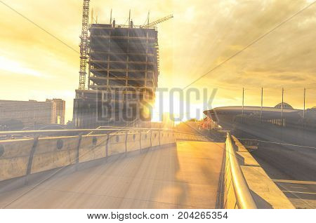 Katowice, Silesia, Poland - July, 28th: A cityscape with a construction site at sunset in the center of Katowice with a view to the 'Spodek' sports hall and the new KTW building under construction on July 28, 2017 in Katowice, Silesia, Poland.