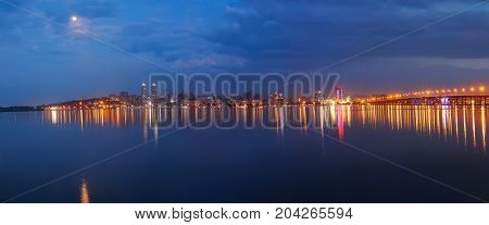 Dnepropetrovsk panorama of the city at night embankment bridge and river Dnepr