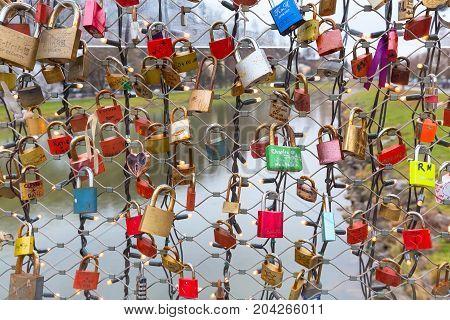 Salzburg, Austria - December 25, 2016: Bridge of locks with love padlocks in Salzburg, Austria
