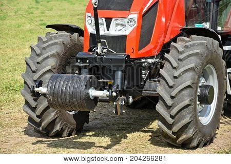 Front part of a tractor outdoors in summer
