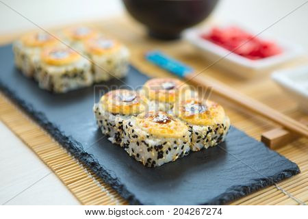 Hot Roll With Cream Cheese. Deep Fried Salmon Outside. Salmon Fried Maki Sushi