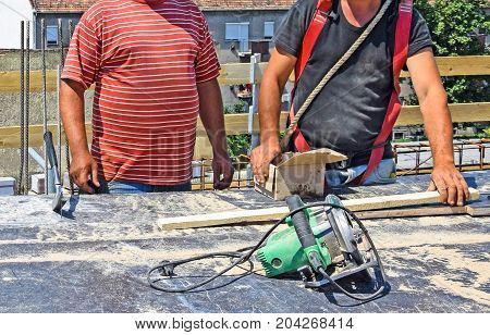 Construction workers at work outdoors in summer