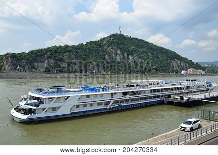 Large tourist boat and the Gellert hill, Budapes, Hungary