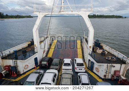 Labuan,Malaysia-Aug 9,2017:Ferry ship transporting people & cars from Labuan island to Menumbok,Sabah,Malaysia.There is a daily ferry service between Menumbok,Sabah and Labuan island,Malaysia