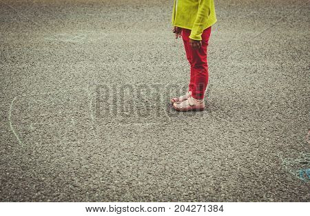 little girl ready to play hopscotch on playground, concept of beginning and start