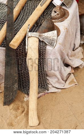 Old Metal Axe Among Other Medieval Weapon And Equipment