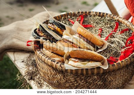 Beautiful Wicker Basket With Some Burgers In It