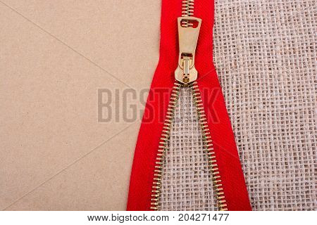 Closeup of a colorful zipper on linen canvas