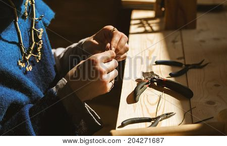 Female Jeweler Working In Her Workshop, Selective Focus