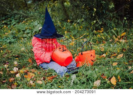 little girl get ready for halloween party outdoors