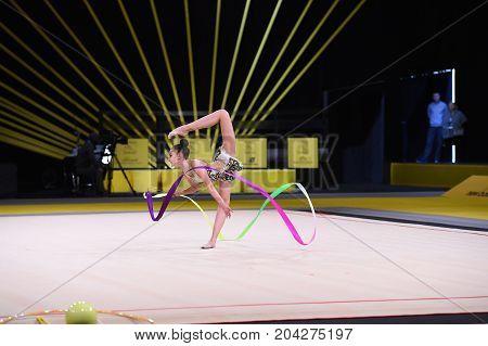 Gymnast Girl Perform At Rhythmic Gymnastics Competition