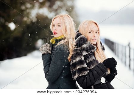 Girls With Long Blond Hair On Snow Landscape