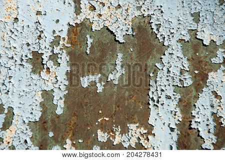 Plate surface with rusty metal texture and old grey paint cracking and peeling on rusted metallized background. Neglect decay and ruin concept