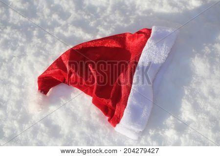 Santa Claus Cap On Snowy Background
