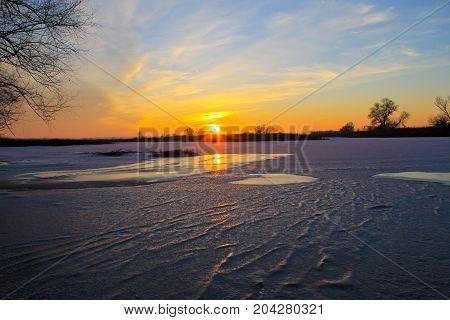 Sunset Over A Frozen River Dnieper On Winter