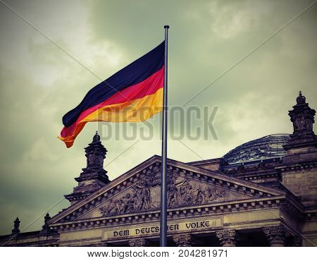 Reichstag Building Is Parliament Of Germany In Berlin With Flag.