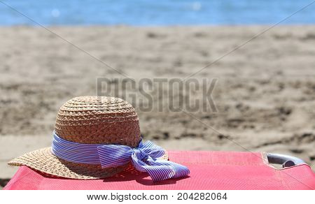 straw hat on the beach in summer