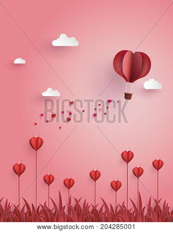 Greeting card of hot air balloon fly over flower field concept of love and Valentine's Day.