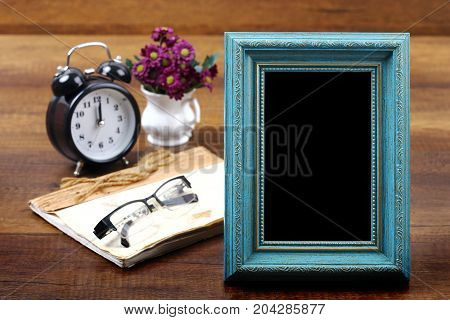 Empty of blue wooden photo frame with item on wood, Travel and vacation background with clipping path.