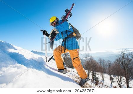 Male Skier Walking Up The Snowy Hill In The Mountains Carrying His Equipment Copyspace Active Lifest
