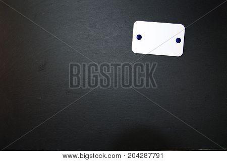 Blackboard made of slate  with blank, writable notepad