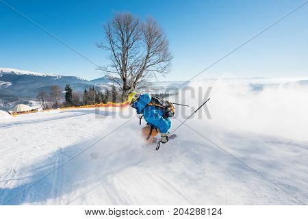 Rearview Shot Of A Skier Riding Down The Slope At Ski Resort In The Carpathians Mountains Copyspace