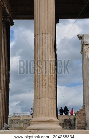 ATHENS GREECE - MAY 6 2014: People and ancient marble column at the Acropolis of Athens Greece.