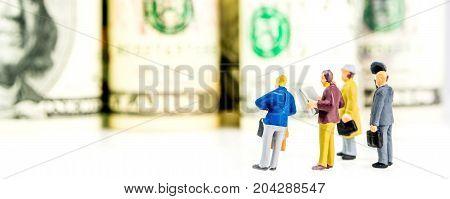 Dollar Rolls And Team Of Miniature Figurines Audience