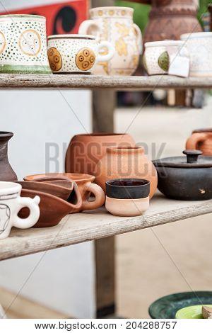 Different Handmade Pottery On A Wooden Shelf, Vertical