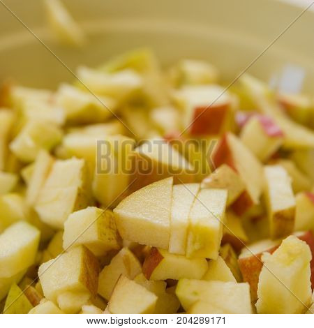 pieces of finely chopped apple lie in a plate